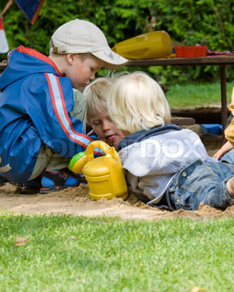 Children in kindergarten playing out  in the garden