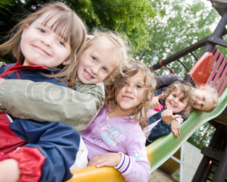 Gilrs in kindergarten on a slide