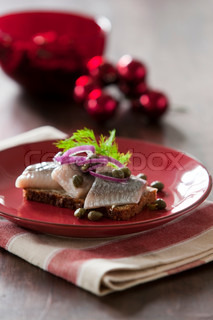 Traditional danish Christmas food for lunch (pickled herring on rye bread)