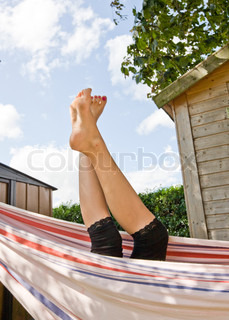 Cropped image of a teenage girl in a hammock