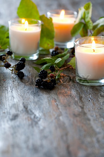 Blackberries and candles used for autumn decoration