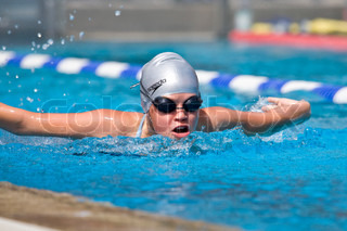 Teenage girl competing in a swimming competition