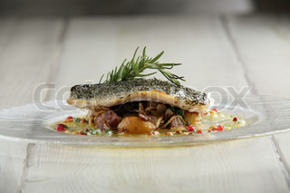 tasty fried fish with mashed herbs