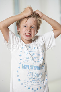 Portrait of a young frustrated caucasian boy