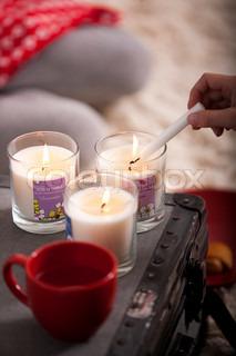 Young girl lighting some scented Christmas
