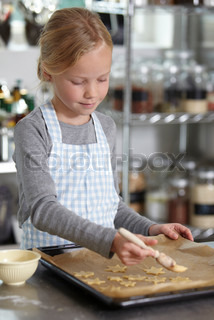 A caucasian girl preparing to bake cookies