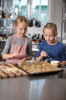Two girls baking breads and cookies