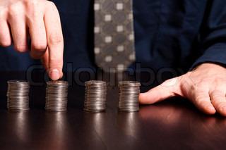 Billede af 'kroner, mønten, hånd'