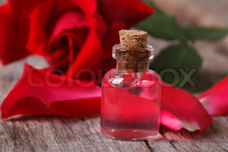 fragrant rose oil in a bottle horizontal macro