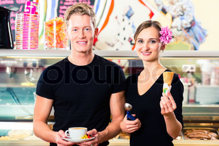 Ice cream seller and waiter working in cafe