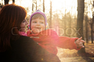 Happy mother and child hugging