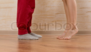 Two Little Feet on Wooden Floor