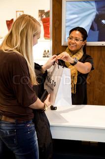 Caucasian women shopping for shoes