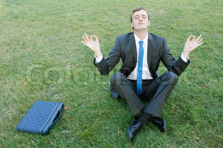 A caucasian businessmanin yoga position