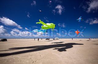 Big green kite in the blue air on Fanoe Island, Denmark