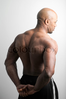 toned and ripped lean muscle fitness man isolated over a white