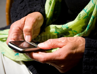 Senior writing a text message on her mobile phone.