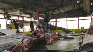 A butcher at a slaughterhouse in Ghana in Africa