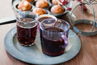 Glogg - a traditional danish Christmas beverage served hot and some danish doughnut