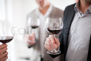 A group caucasian businessmen drinking red wine
