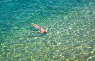 Child enjoying herself in the sea at the Croatian coast.