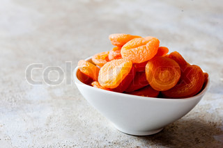 Dried apricot fruit in a bowl