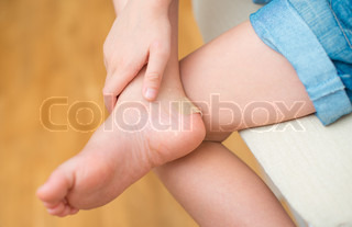 Child rubbed leg after wearing unsuitable shoes.