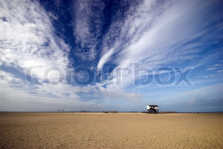 Beach Home. Wooden house on long posts on the beach outside the northwest coast of Germany ? St. Peter-Ording Beach.