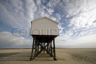 Close Up Beach House Wooden house on long posts on the beach outside the northwest coast of Germany ? St. Peter-Ording Beach.