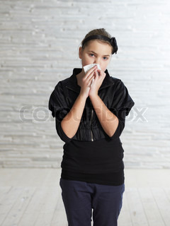 Portrait - a teenage caucasian girl sick with colds