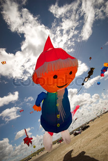 Fantasy Kite High-Up in the Sky a Sunny Day on the Beach