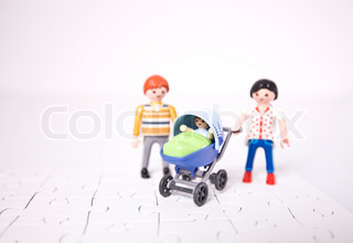 Concept of a young family standing over a puzzle board