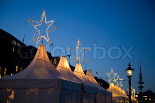 Top of tents with stars - Christmas Market, Hamburg - Germany. Space for text.
