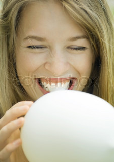 Image of 'balloon, woman, blowing'