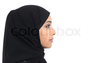 Profile of an arab saudi emirates woman covered with black scarf