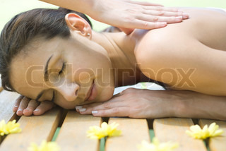Image of 'wellness, massage, dark haired'