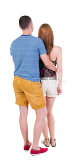Back view of young embracing couple (man and woman) hug and look