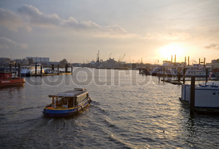 Sunset in the harbor of Hamburg - Germany.