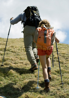 Rear view of two hikers going uphill