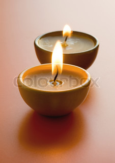 Close-up of two lit candles
