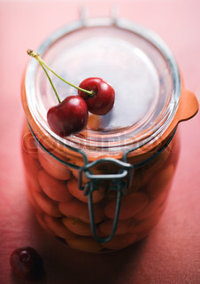 Preserved cherries in a jar
