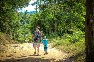 father and son traveling in jungle forest on Koh Samui
