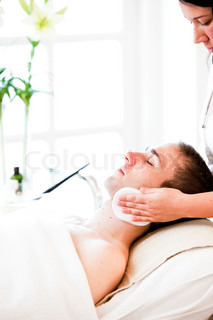 A male caucasian in a wellness spa getting massage