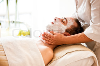 A male caucasian in a wellness spa getting facial treatment