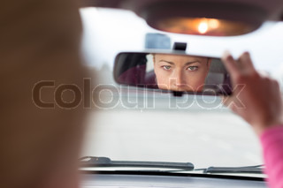 Lady looking back while reversing.