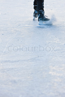 Ice skating in frozen lake