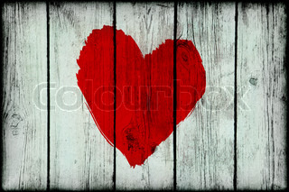 Red bright abstract heart on old wooden grunge wall