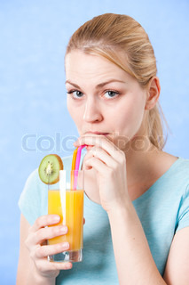 Portrait - blond woman drinking orange juice