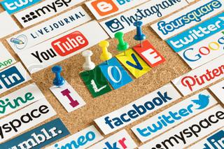 BELGRADE - JUNE 17, 2014 Social media website logos Facebook, Twitter and words I love printed on paper and pinned on cork bulletin board