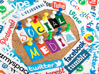 BELGRADE - JUNE 13, 2014 Social media words made from letters pinned to a cork bulletin board and social media website logos printed on paper